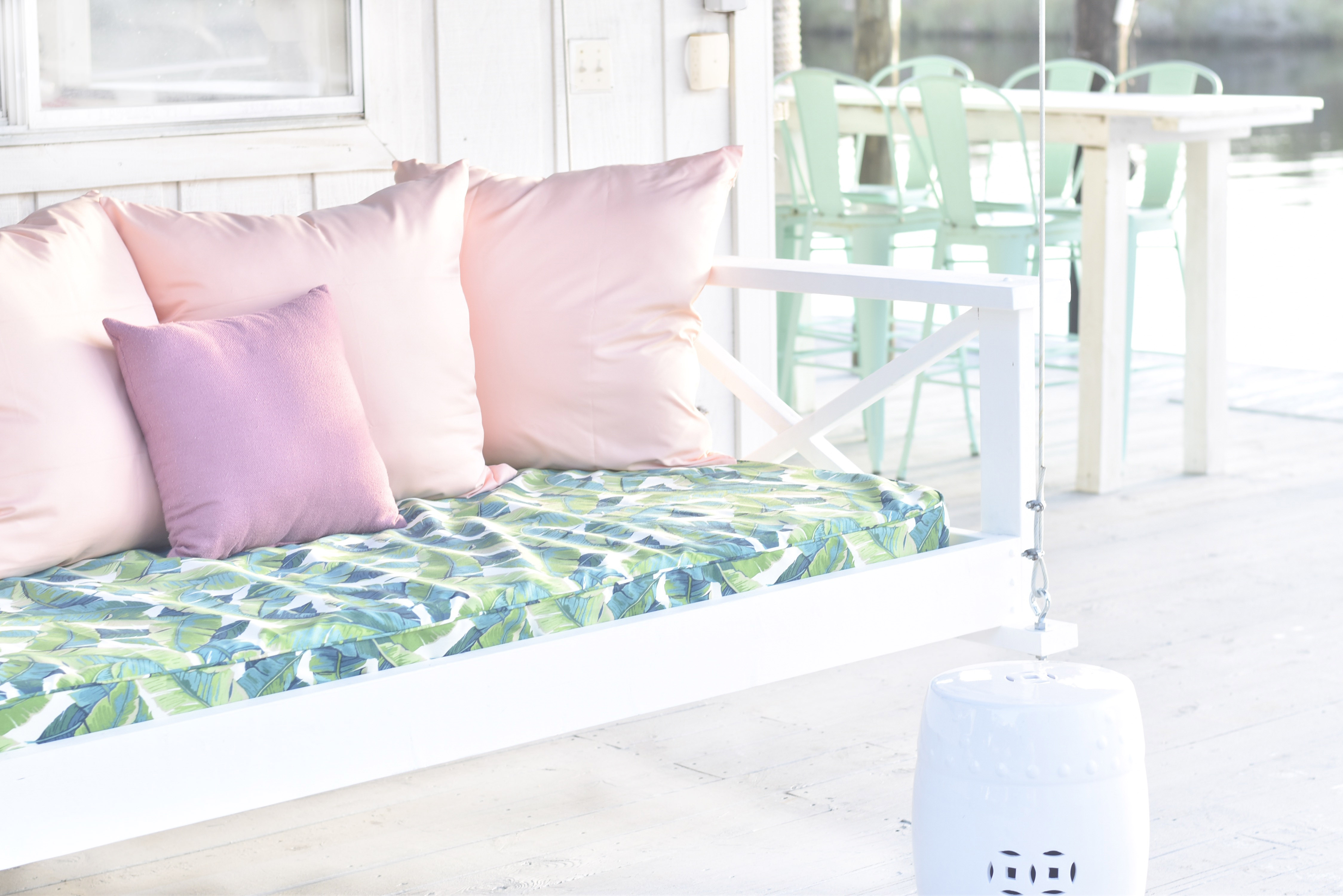 Jami Ray's chic swing bed on the dock by Nate and Lane